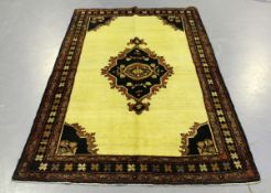 A Saveh rug, North-west Persia, mid-20th century, the ivory field with a large shaped medallion,