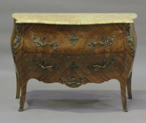 A 20th century French kingwood and foliate inlaid two-drawer bombé commode, the marble top above