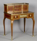 A late 19th/early 20th century French kingwood and thuya writing desk with overall applied gilt