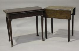A George II mahogany fold-over card table, fitted with a concealed oak-lined frieze drawer, height