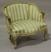 An early 20th century French Rococo Revival limed walnut showframe armchair, height 72cm, width