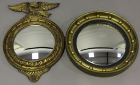 A 20th century Regency style giltwood convex wall mirror with eagle surmount, 56cm x 36cm,