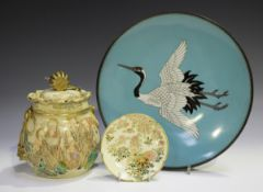 A Japanese Satsuma earthenware jar and cover, Meiji period, the bulbous body painted and gilt with a