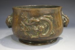 A Chinese brown patinated bronze bombé censer, the body cast in relief with opposing dragons,