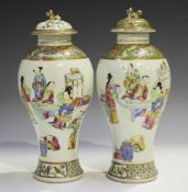 A pair of Chinese Canton famille rose porcelain vases and covers, mid-19th century, each high-