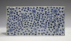 A Chinese blue and white porcelain pillow, late Qing dynasty, of rectangular form, painted to the