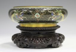A Chinese cloisonné bowl, early 20th century, of shallow circular form, decorated with dragons on