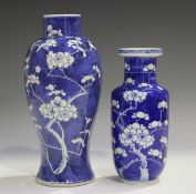 A Chinese blue and white porcelain vase, mark of Kangxi but late 19th century, the baluster body