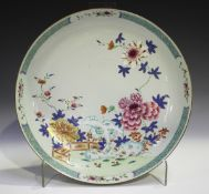 A Chinese famille rose export porcelain circular dish, Yongzheng/Qianlong period, painted with a