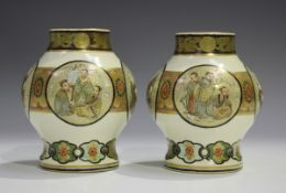 A pair of Japanese Satsuma earthenware vases by Taizan, Meiji period, each stout baluster body