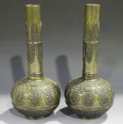 A pair of Chinese brown patinated bronze bottle vases, late Qing dynasty, each globular body cast