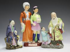 A Chinese famille rose porcelain figure group, mid-20th century, modelled as Shoulao and boy