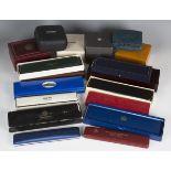 A collection of thirty-four wristwatch boxes, including Breguet, Bucherer, Bulova, Bueche-Girod,