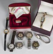 A Bravingtons Renown steel cased gentleman's wristwatch, case diameter 3.2cm, a silver circular