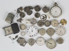 A collection of Movado watch movements, dials and case parts, including a base metal cased pocket