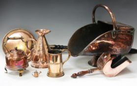 A group of Victorian and later copper wares, including a substantial coal scuttle with shovel, a '