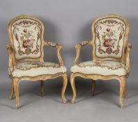 A pair of 18th century French Rococo walnut showframe fauteuil armchairs, probably by Jean-