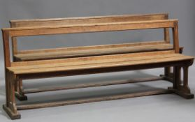 A pair of late 19th century oak pews with chamfered edges and Gothic arch supports, height 82cm,