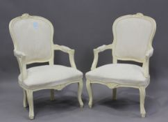 A pair of late 20th century French cream painted showframe fauteuil armchairs, height 91cm, width