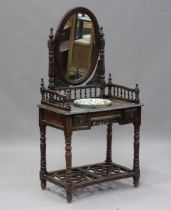 A 20th century Chinese stained softwood washstand with oval swing frame mirror, height 158cm,