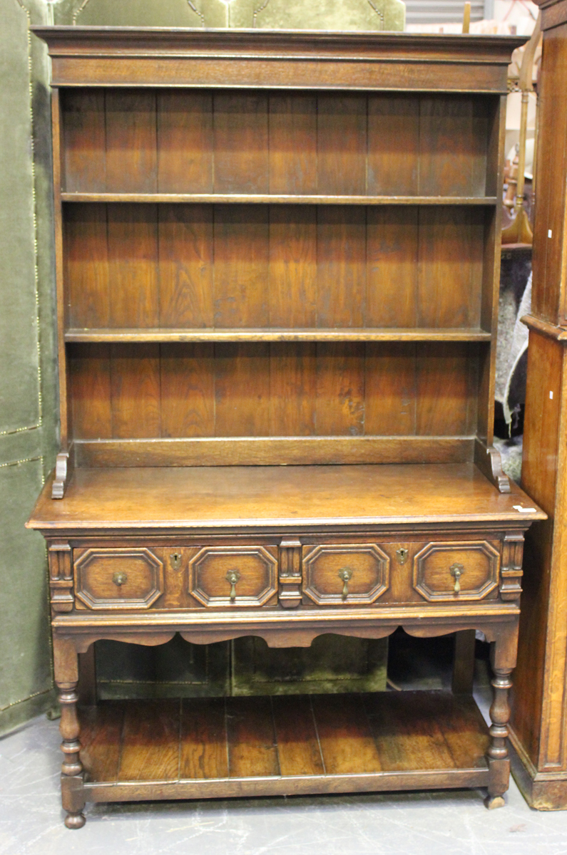 A 20th century Jacobean Revival oak dresser, the shelf back above two frieze drawers, on turned