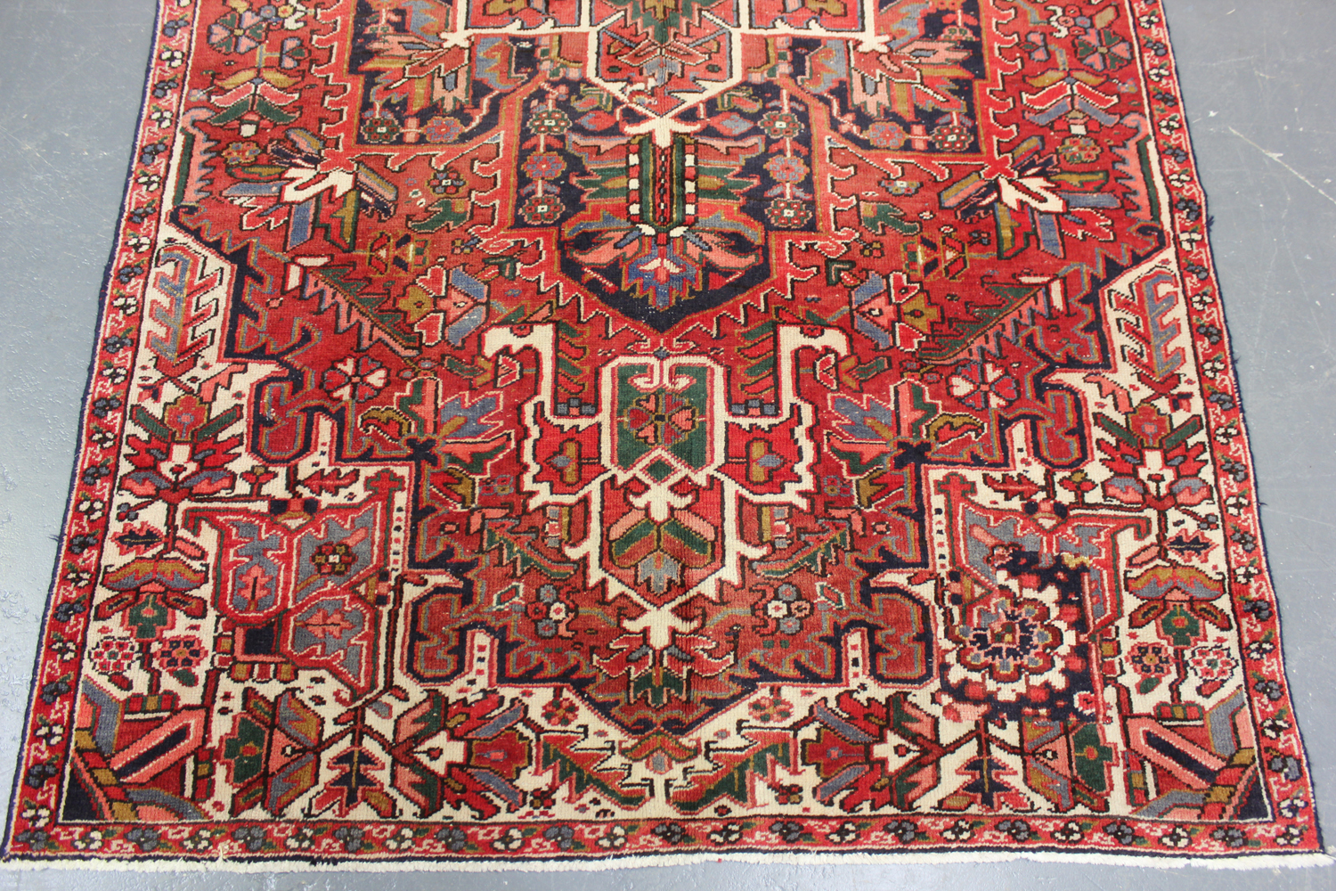 A Heriz rug, North-west Persia, mid-20th century, the terracotta field with a bold flowerhead - Image 2 of 5