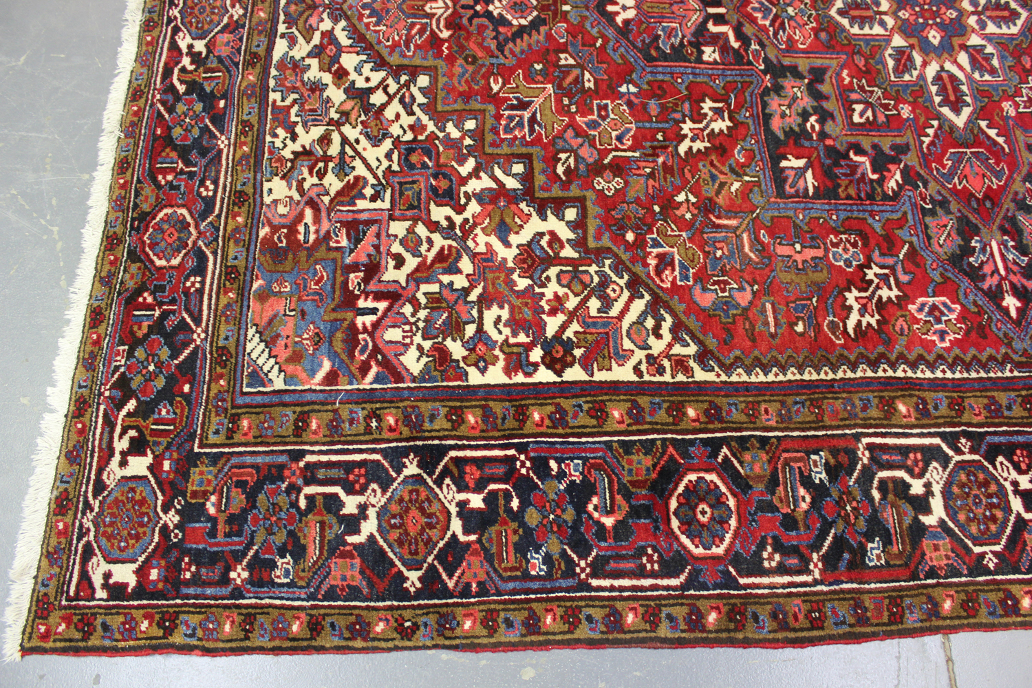 A Heriz carpet, North-west Persia, mid-20th century, the red field with a bold flowerhead - Image 5 of 6