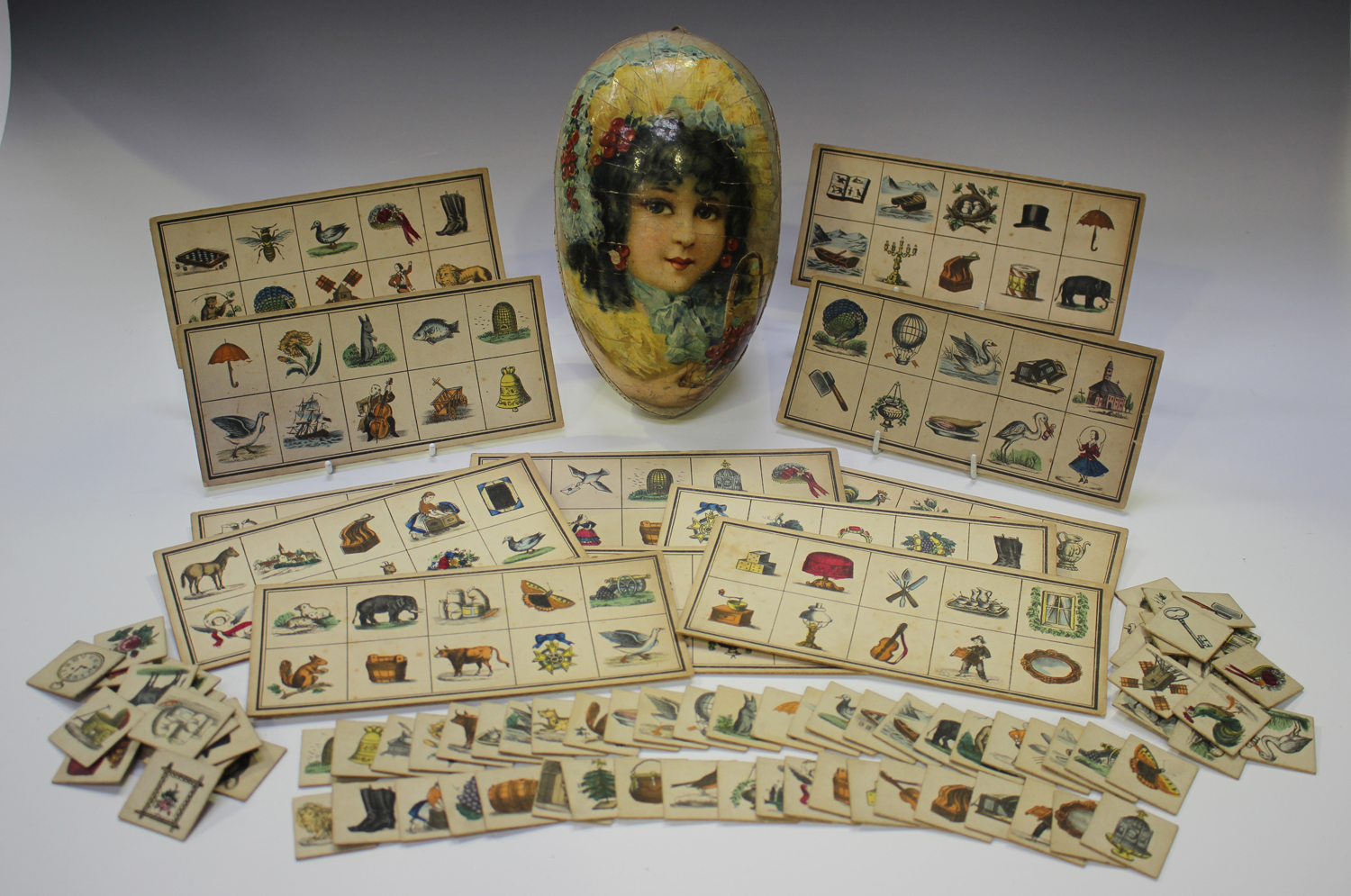 An early/mid-19th century chromolithographed child's picture puzzle game, comprising twelve cards