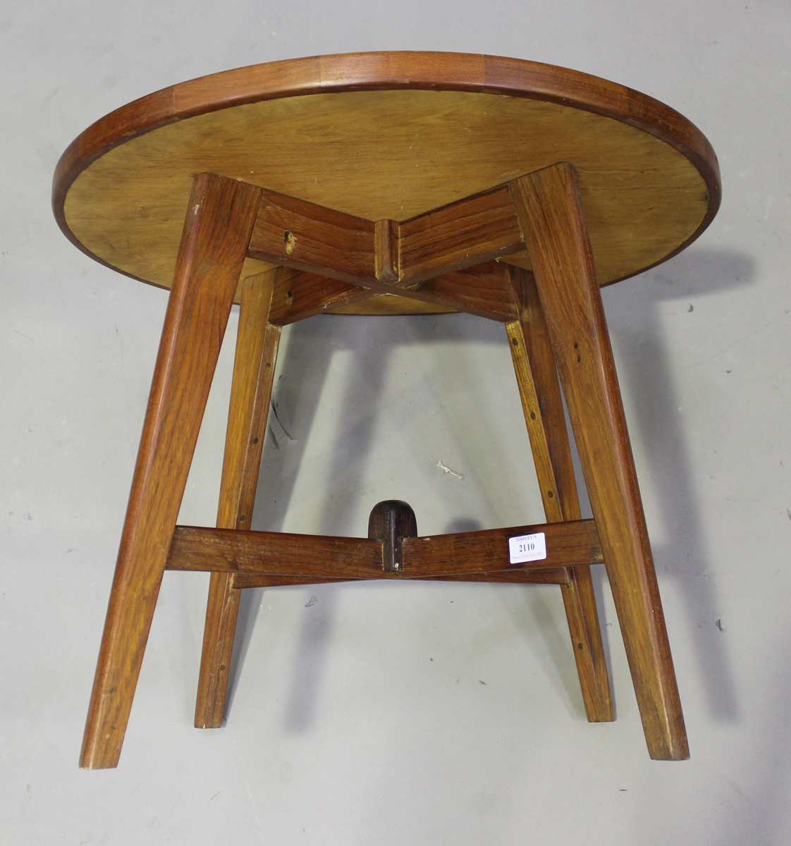 A mid-20th century teak circular occasional table of retro design, the planked top with raised edge, - Image 2 of 4