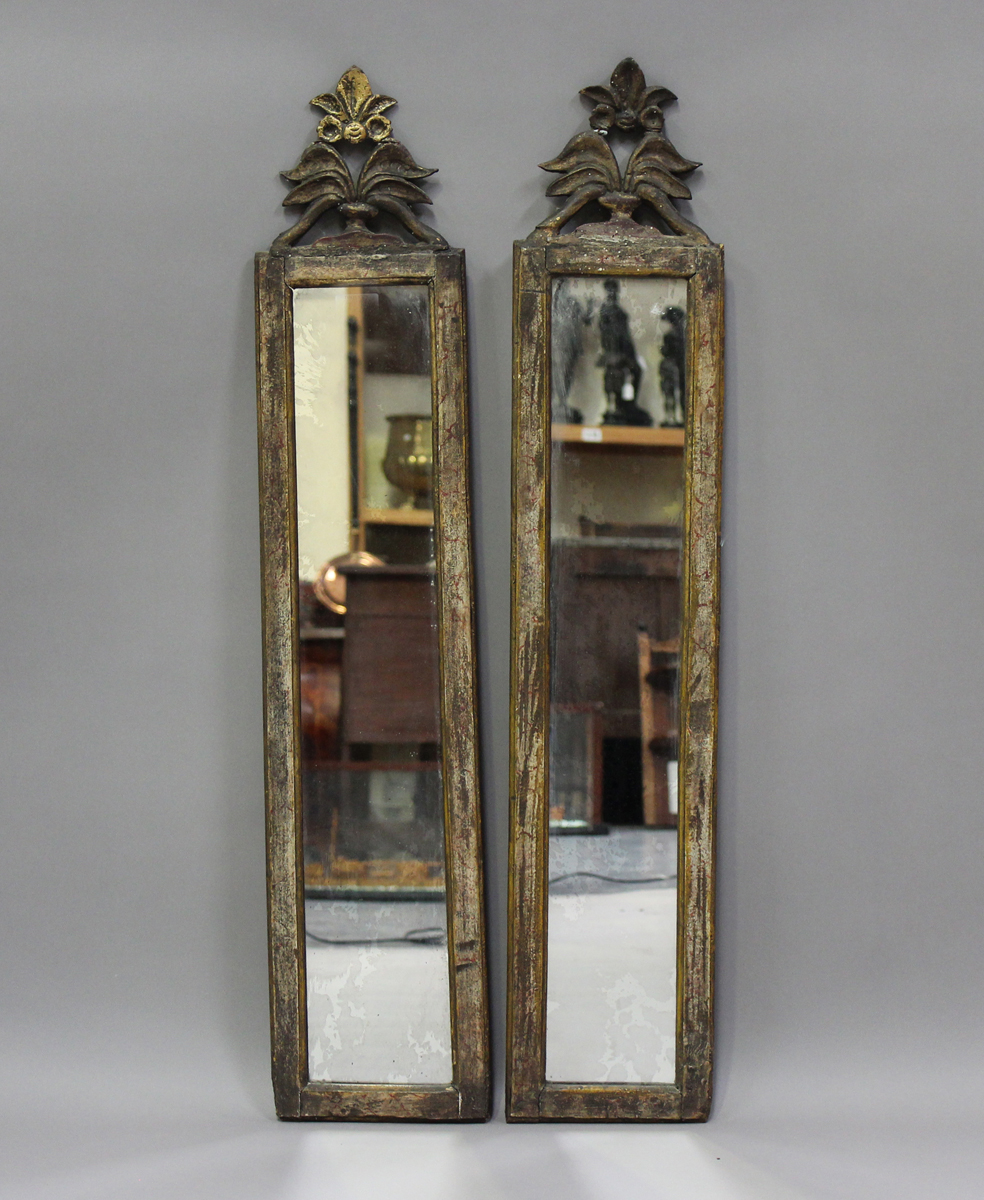 A pair of Italian gilt and simulated marble pier mirrors, probably 18th century, each narrow frame