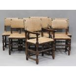 A set of eight Jacobean Revival oak dining chairs with light brown leather seats and backs,