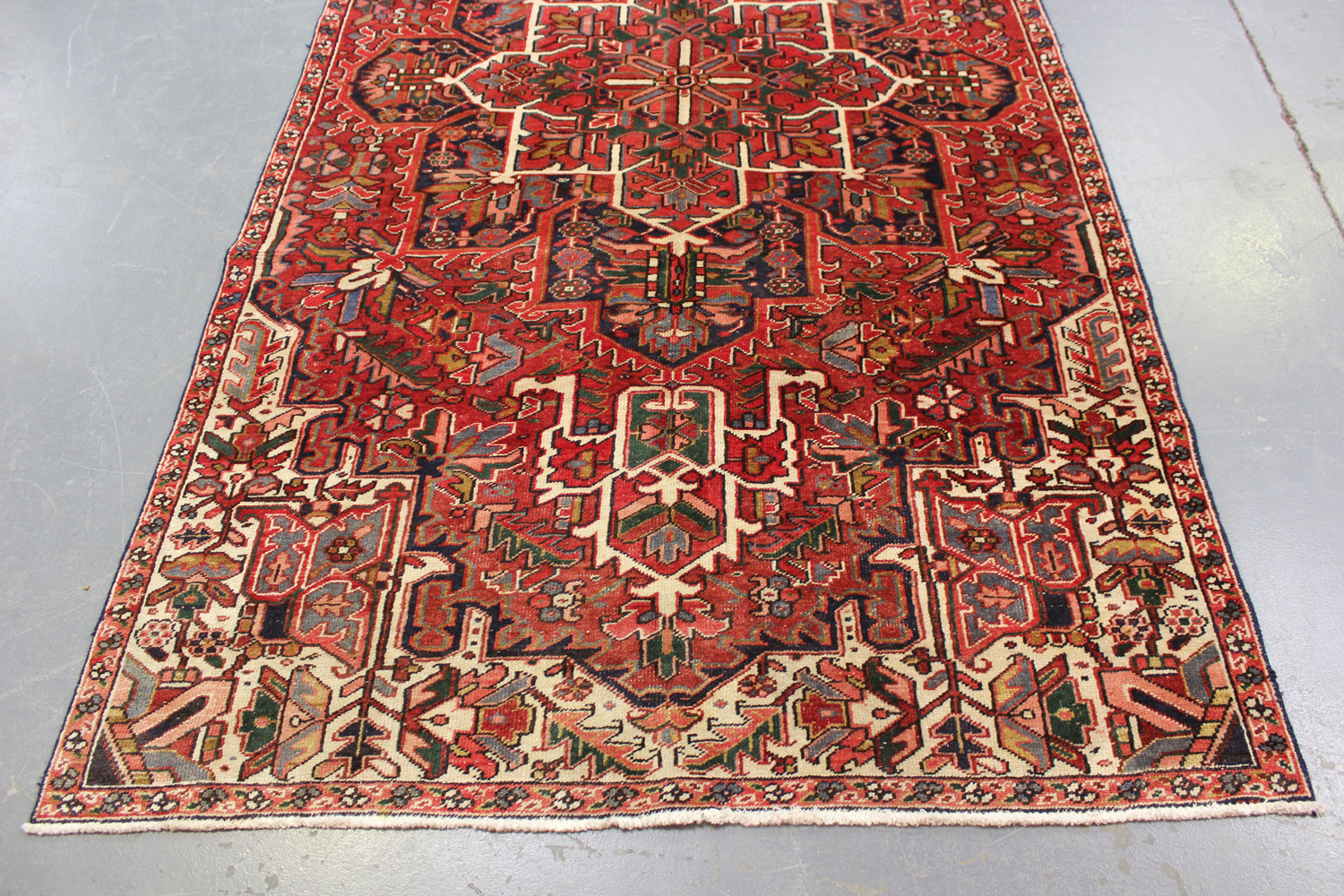 A Heriz rug, North-west Persia, mid-20th century, the terracotta field with a bold flowerhead - Image 4 of 5