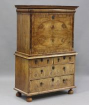 A Queen Anne walnut escritoire, the pediment and cushion frieze drawer above a fall-front