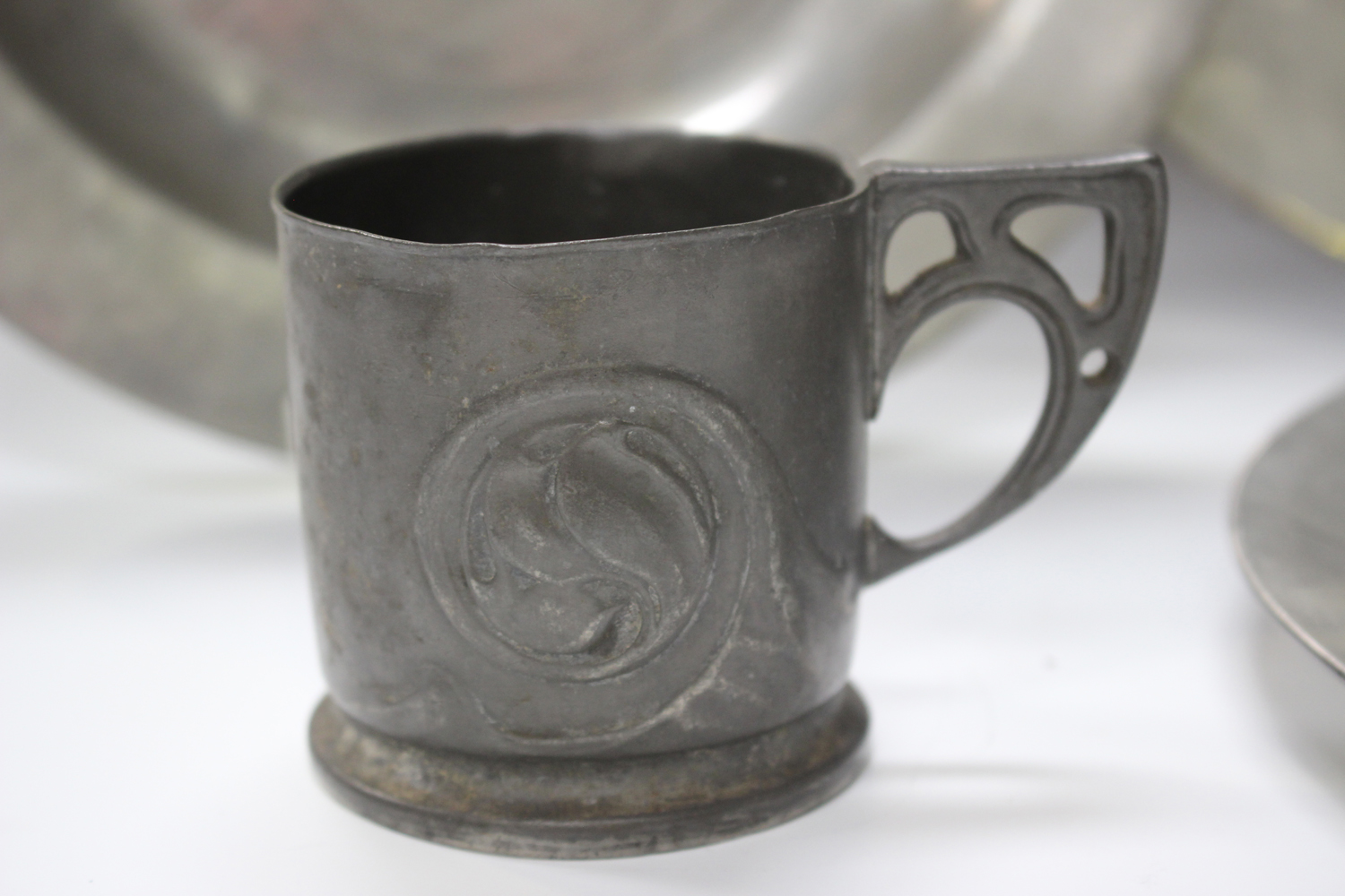 A small group of pewter items, comprising a Liberty 'Tudric' cup, model number '0558', height 6.5cm, - Image 10 of 11