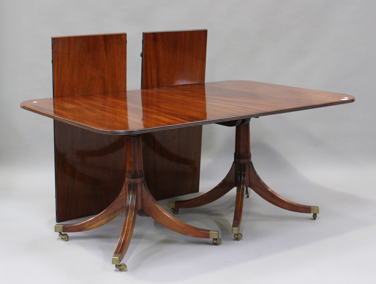 A 20th century George III style mahogany twin pedestal dining table with two extra leaves, height