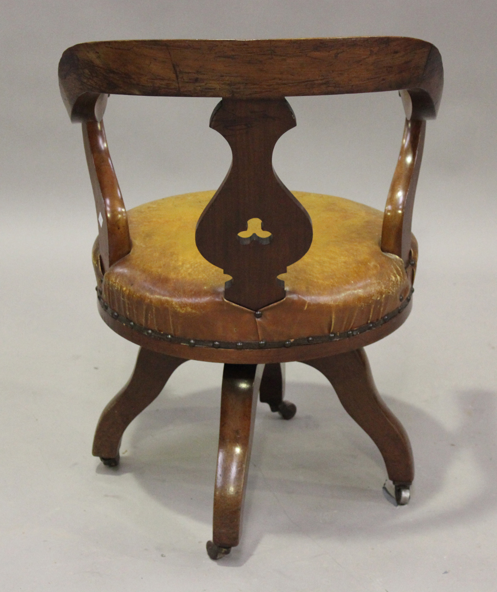 A late Victorian mahogany framed tub back revolving desk chair with a circular brown leather seat, - Image 2 of 4
