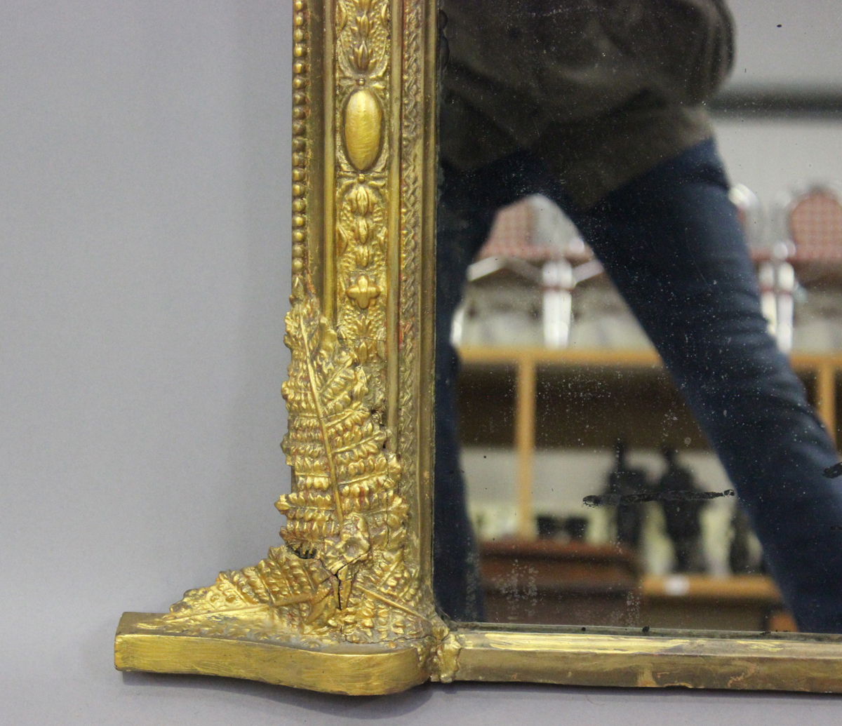 A late Victorian gilt painted overmantel mirror, the arched frame with putto and fern surmount, - Image 3 of 4