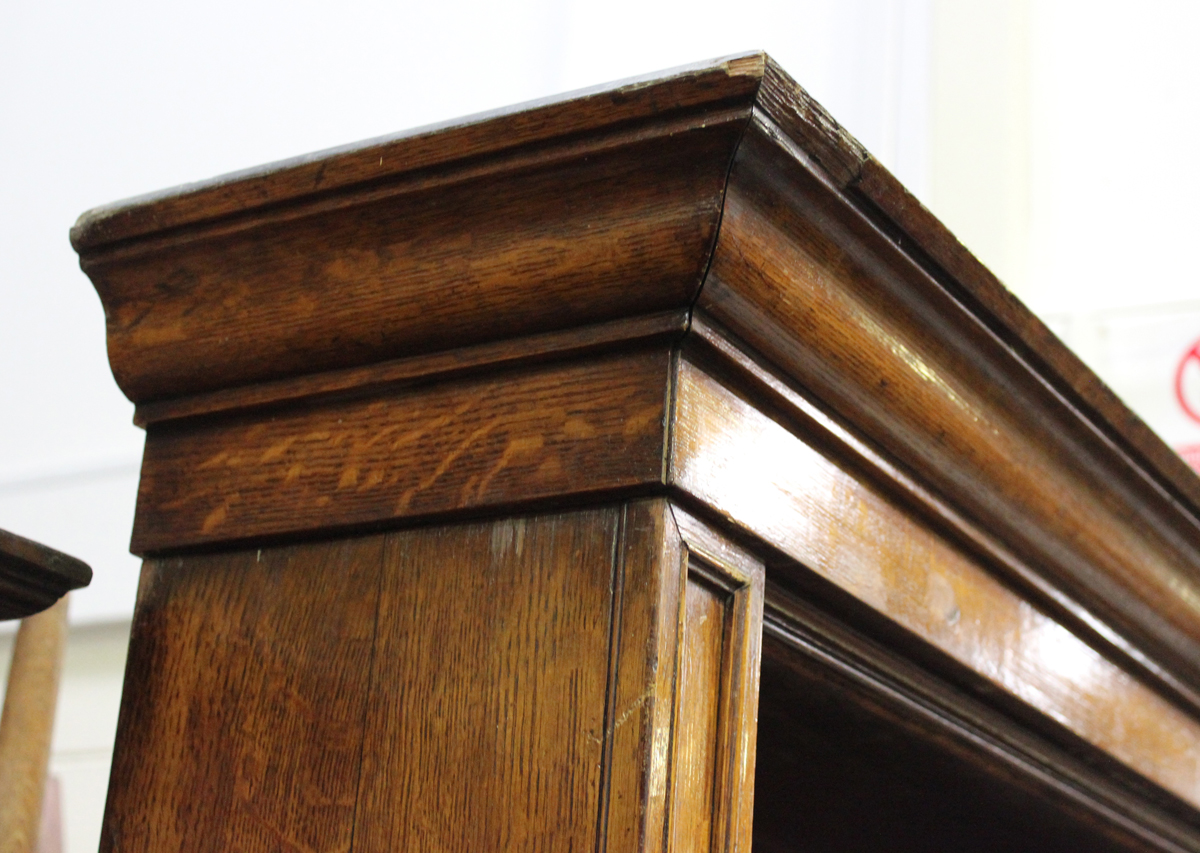 A Victorian oak open library bookcase, the moulded pediment above adjustable shelves, on a plinth - Image 3 of 5