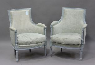 A pair of late 18th century French Louis XVI later painted showframe fauteuil armchairs, upholstered