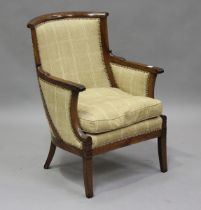 An early 19th century mahogany showframe library armchair, possibly Russian, covered in a checked