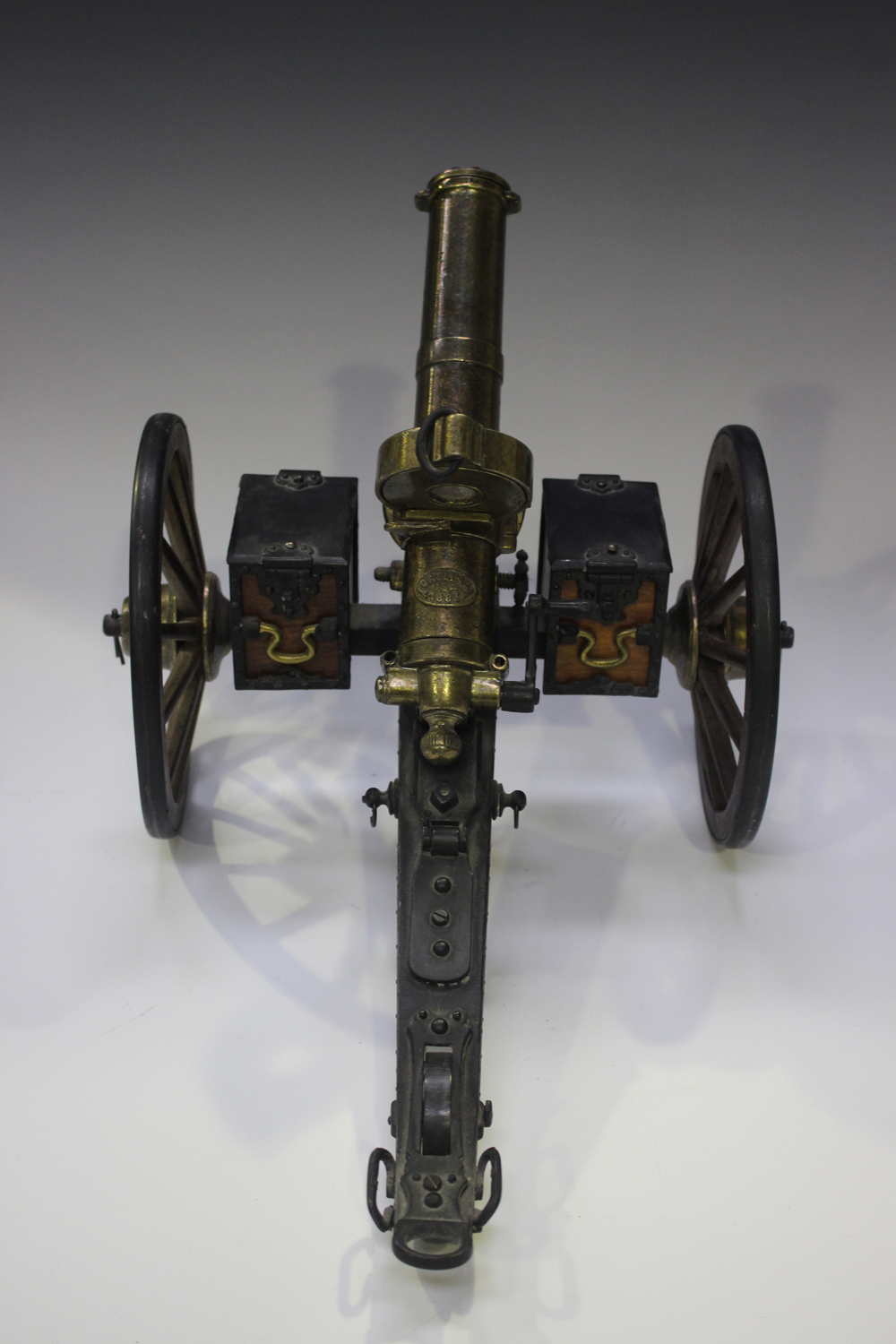 A late 20th century cast metal and wooden desk model of Gatling gun, mounted on a wheeled - Image 4 of 4