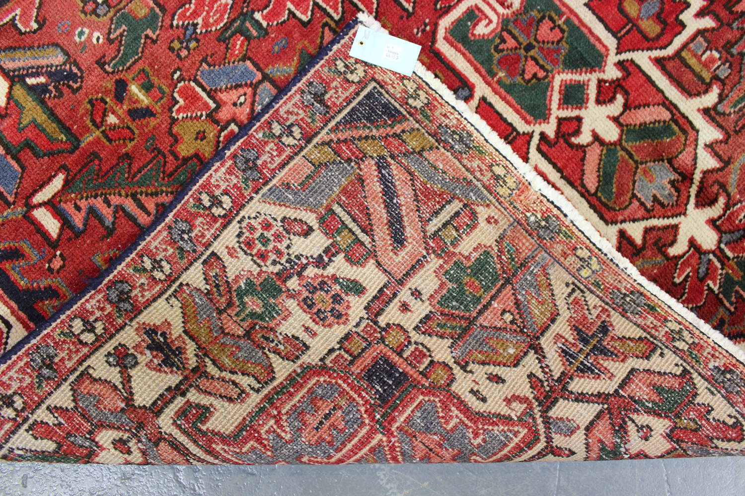 A Heriz rug, North-west Persia, mid-20th century, the terracotta field with a bold flowerhead - Image 5 of 5