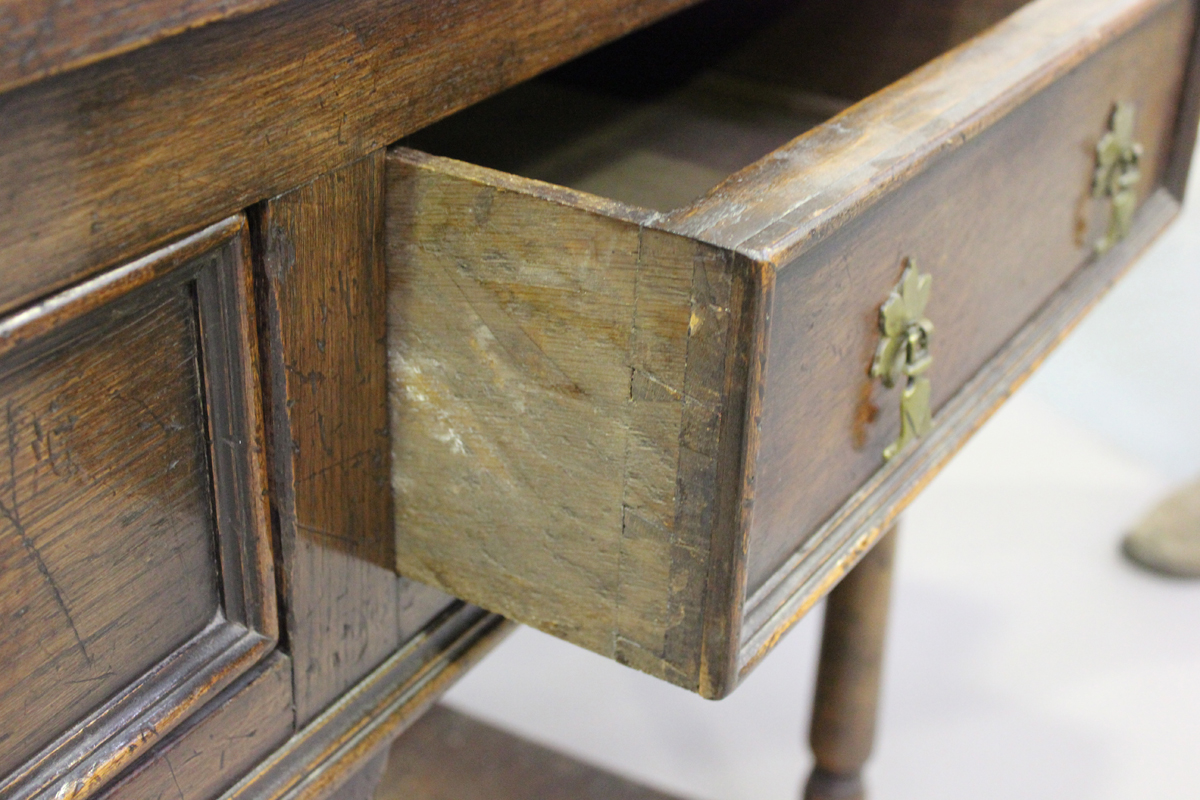 An early 20th century oak dresser, fitted with a plate rack above three drawers and a pot shelf, - Image 3 of 6