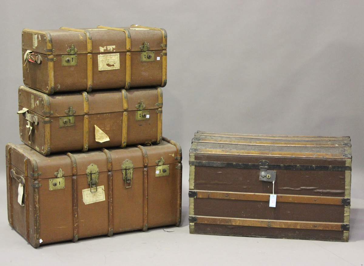 An early 20th century wooden and metal bound trunk, height 55cm, width 91cm, depth 51cm, together
