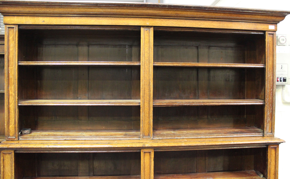 A Victorian oak open library bookcase, the moulded pediment above adjustable shelves, on a plinth - Image 4 of 5