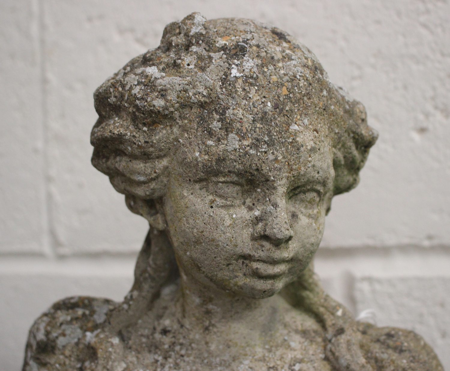 A near pair of late 20th century cast composition stone garden figures, raised on foliate - Image 3 of 4