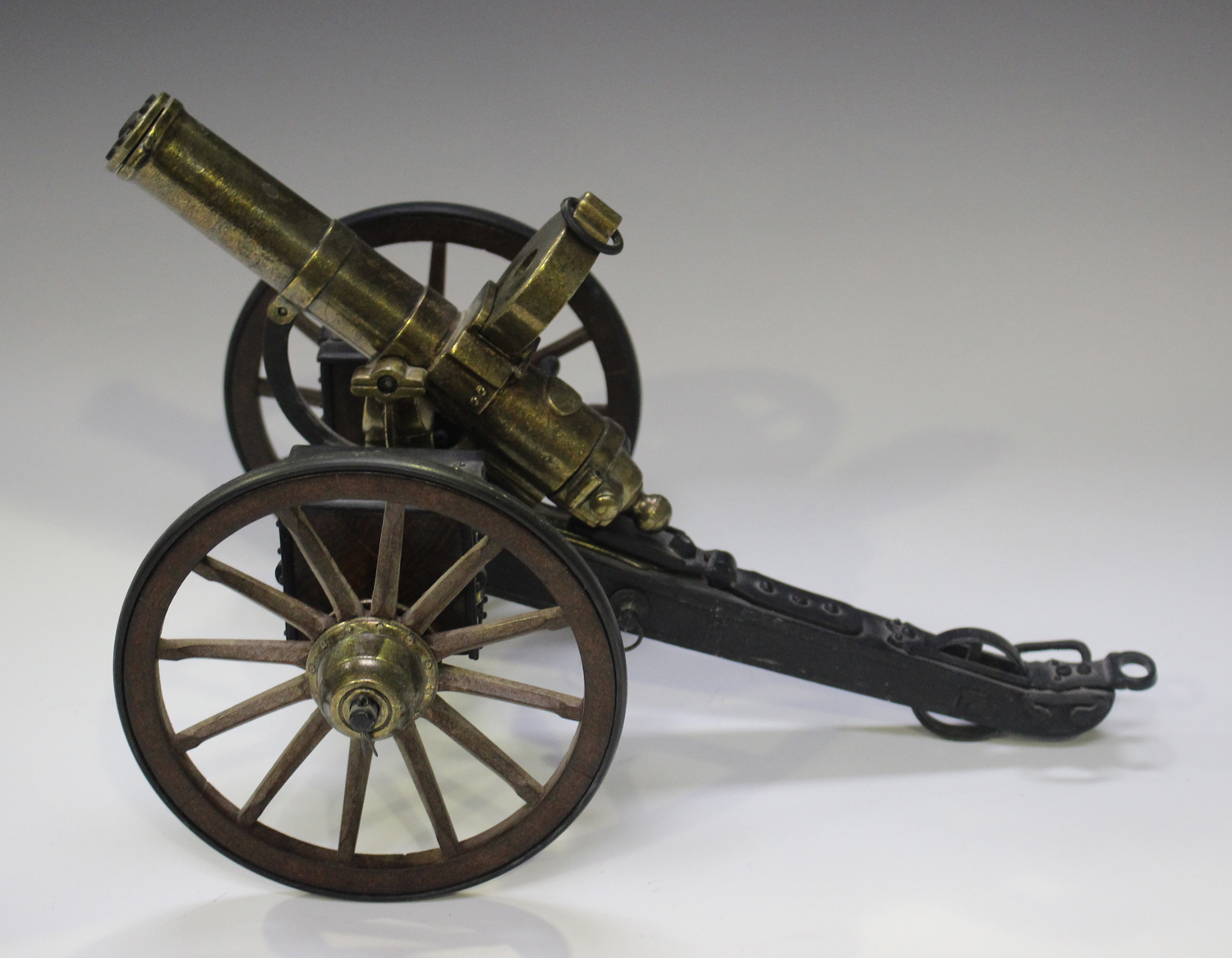 A late 20th century cast metal and wooden desk model of Gatling gun, mounted on a wheeled - Image 2 of 4