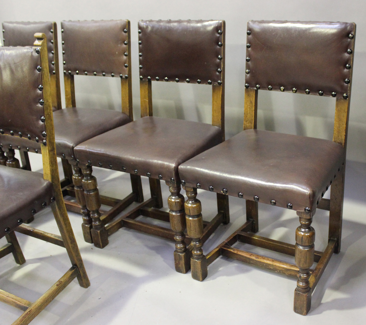 An early/mid-20th century harlequin set of seven oak framed dining chairs, comprising a set of - Image 3 of 4