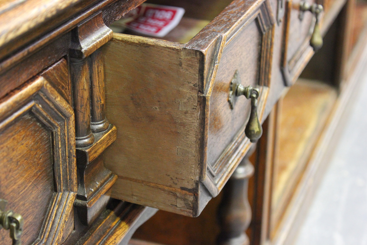 A 20th century Jacobean Revival oak dresser, the shelf back above two frieze drawers, on turned - Image 2 of 5