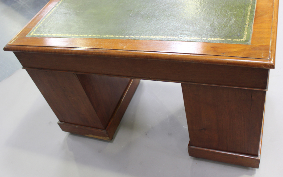 A late Victorian walnut twin pedestal desk, fitted with an arrangement of drawers, on plinth - Image 3 of 5